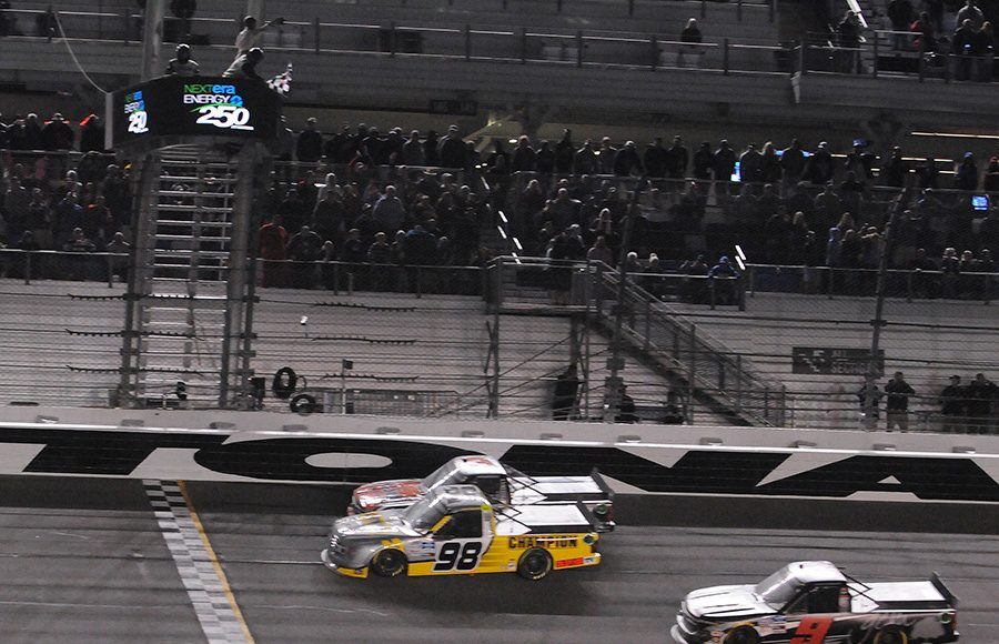 Grant Eninger (98) inches ahead of Jordan Anderson to win Friday's NASCAR Gander RV & Outdoors Truck Series opener at Daytona Int'l Speedway. (Dave Moulthrop Photo)