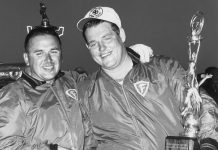 DAYTONA BEACH, FL - FEBRUARY 24, 1963: Tiny Lund (right) was a last-minute substitute for the Wood Brothers team after their regular driver Marvin Panch was injured in an earlier crash. In storybook fashion, Lund took the race and became a much-loved figure in early NASCAR racing. (Photo by RacingOne/Getty Images)
