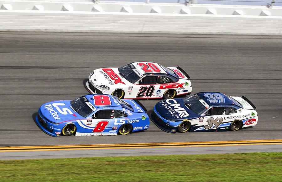 Jeb Burton (8) battles Harrison Burton (20) and Ryan Sieg during Saturday's NASCAR Xfinity Series opener at Daytona Int'l Speedway. (Dick Ayers Photo)