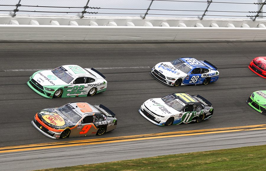 Noah Gragson (9) and Austin Cindric (22) lead a pack of cars during Saturday's NASCAR Xfinity Series opener at Daytona Int'l Speedway. (Dick Ayers Photo)