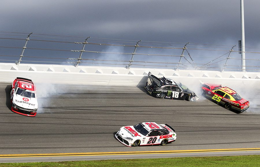 Harrison Burton (20) sneaks by the crashing cars of Myatt Snider (21), Riley Herbst (18) and Chris Cockrum during Saturday's NASCAR Xfinity Series opener at Daytona Int'l Speedway. (Dick Ayers Photo)