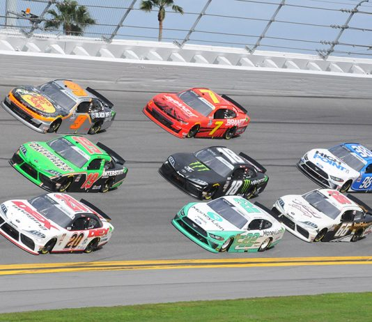 Harrison Burton (20), Brandon Jones (19) and Noah Gragson (9) race three-wide at the front of the field during Saturday's NASCAR Xfinity Series race at Daytona Int'l Speedway. (Dave Moulthrop Photo)