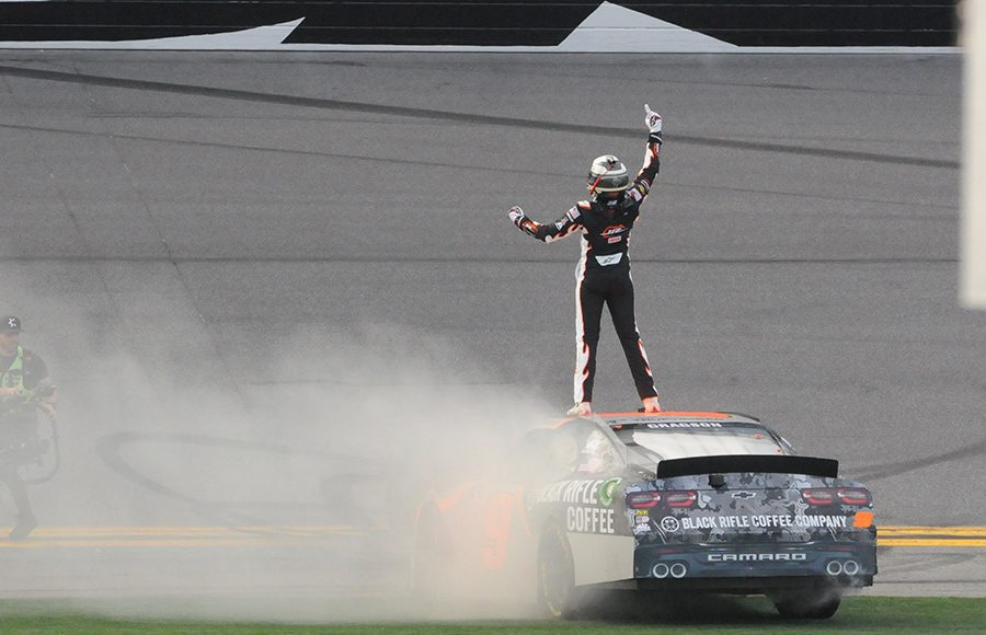 Noah Gragson celebrates atop his race car after winning Saturday's NASCAR Xfinity Series opener at Daytona Int'l Speedway. (Dave Moulthrop Photo)