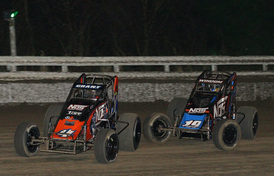 Justin Grant (4) races ahead of Chris Windom during Friday's USAC AMSOIL National Sprint Car Series opener at Bubba Raceway Park. (Todd Ridgeway Photo)