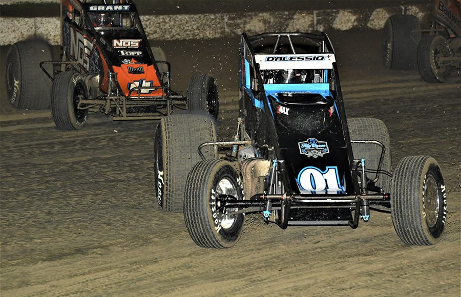 Anthony D'Alessio (01) races under Justin Grant during Friday's USAC AMSOIL National Sprint Car Series opener at Bubba Raceway Park. (Al Steinberg Photo)