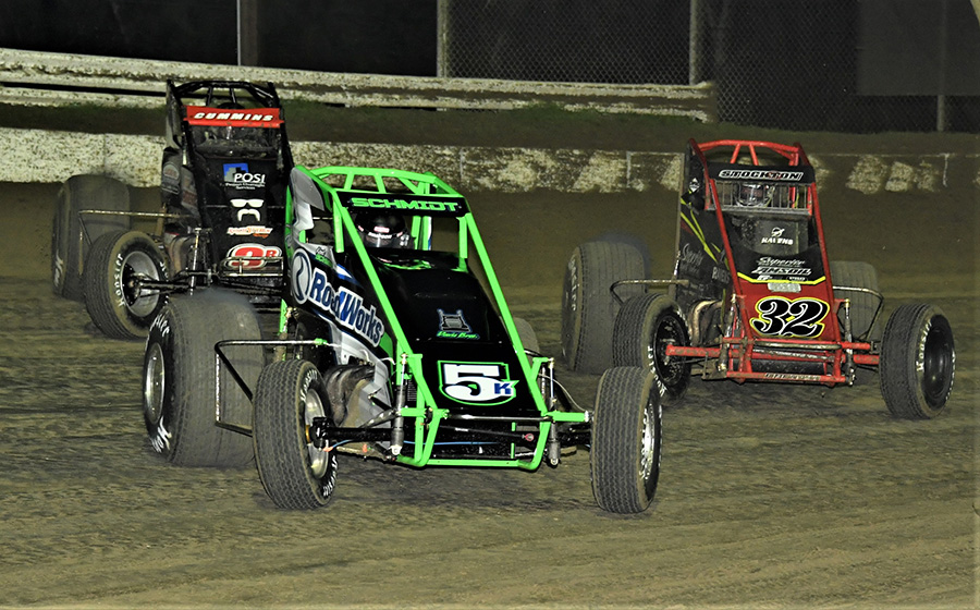 Kent Schmidt (5k) races ahead of leaders Kyle Cummins (3r) and Kevin Thomas Jr. during Friday's USAC AMSOIL National Sprint Car Series opener at Bubba Raceway Park. (Al Steinberg Photo)