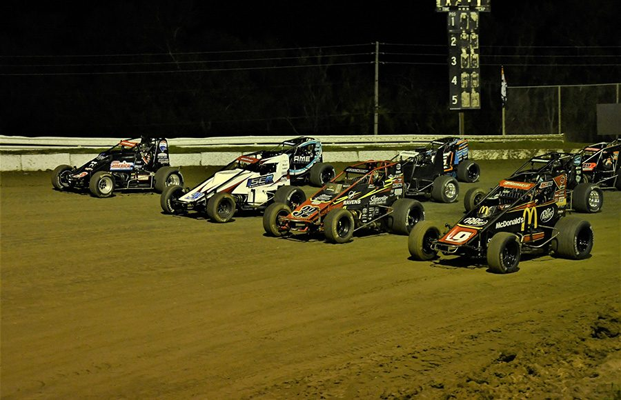 The field for Friday's USAC AMSOIL National Sprint Car Series event forms up four-wide at Bubba Raceway Park. (Al Steinberg Photo)