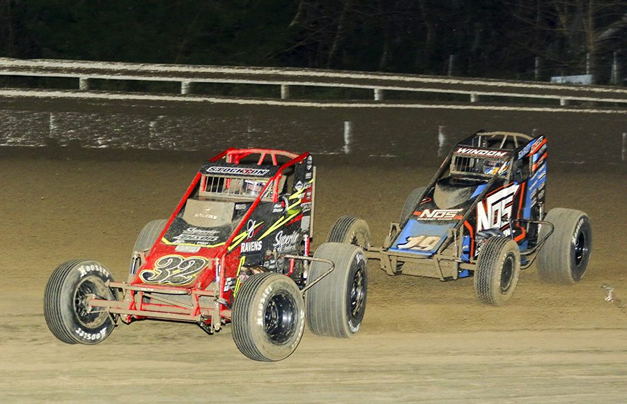 Chase Stockon (32) leads Chris Windom during Friday's USAC AMSOIL National Sprint Car Series opener at Bubba Raceway Park. (Dick Ayers Photo)