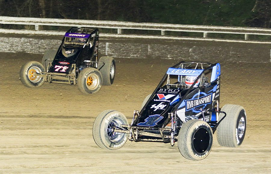 C.J. Leary (1) races under Carson Short during Friday's USAC AMSOIL National Sprint Car Series opener at Bubba Raceway Park. (Dick Ayers Photo)