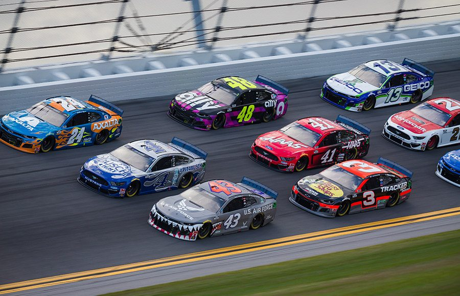 William Byron (24), Kevin Harvick (4) and Bubba Wallace race three-wide during the Daytona 500. (HHP/Chris Owens Photo)