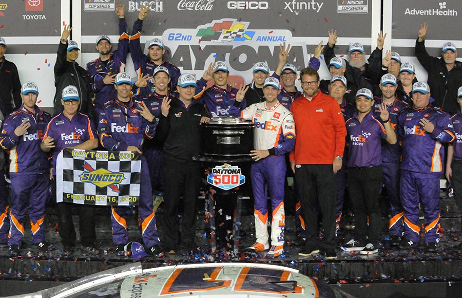 Denny Hamlin poses in victory lane with his team after winning the Daytona 500. (Dave Moulthrop Photo)