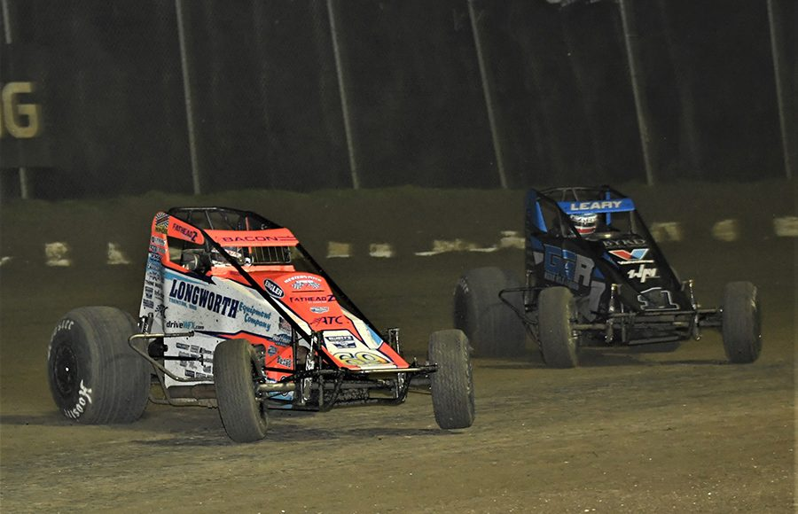 Brady Bacon (69) races ahead of C.J. Leary during Saturday's USAC AMSOIL National Sprint Car Series event at Bubba Raceway Park. (Al Steinberg Photo)