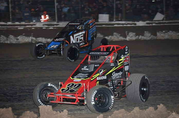 Chase Stockon (32) races under Chris Windom during Saturday's USAC AMSOIL National Sprint Car Series event at Bubba Raceway Park. (Max Dolder Photo)