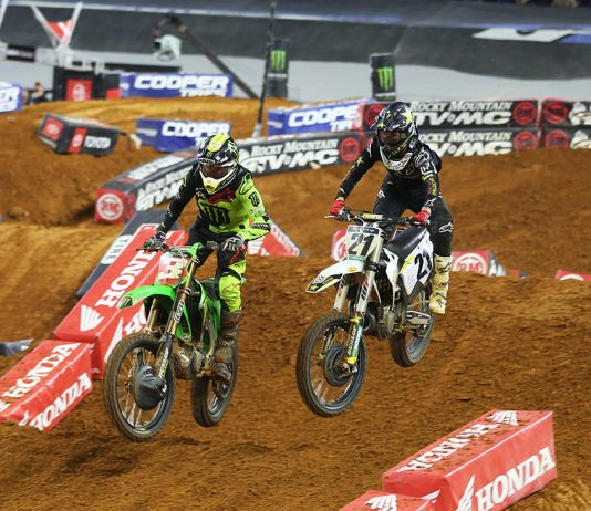 Eli Tomac (3) passes Jason Anderson inside AT&T Stadium in Arlington, Texas. (Michael Diers photo)