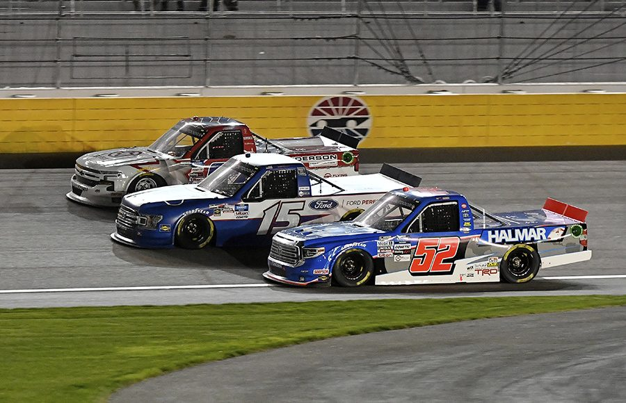 Stewart Friesen (52), Tanner Gray (15) and Austin Wayne Self battle three-wide during Friday's NASCAR Gander RV & Outdoors Truck Series event at Las Vegas Motor Speedway. (Toyota Photo)