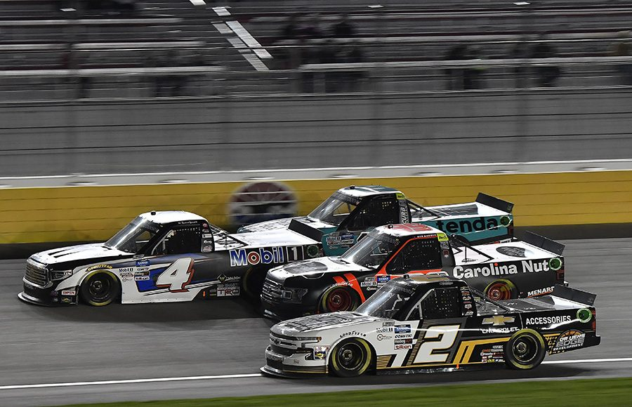 Sheldon Creed (2), Ben Rhodes (99), Raphael Lessard (4) and Johnny Sauter battle four-wide during Friday's NASCAR Gander RV & Outdoors Truck Series event at Las Vegas Motor Speedway. (Toyota Photo)