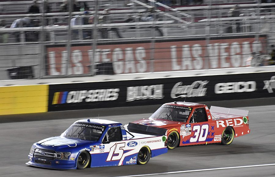 Tanner Gray (15) races ahead of Brennan Poole during Friday's NASCAR Gander RV & Outdoors Truck Series event at Las Vegas Motor Speedway. (Toyota Photo)