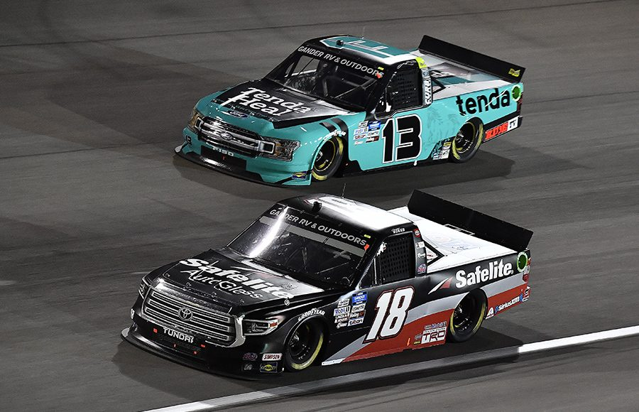 Christian Eckes (18) races ahead of Johnny Sauter during Friday's NASCAR Gander RV & Outdoors Truck Series event at Las Vegas Motor Speedway. (Toyota Photo)
