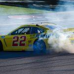 Joey Logano celebrates with a burnout after winning Sunday's race at Las Vegas Motor Speedway. HHP/Chris Owens Photo)