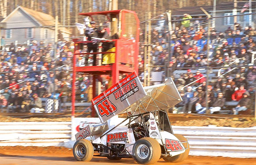 Danny Dietrich takes the checkered flag to win Saturday's Ice Breaker feature at Lincoln Speedway. (Dan Demarco Photo)