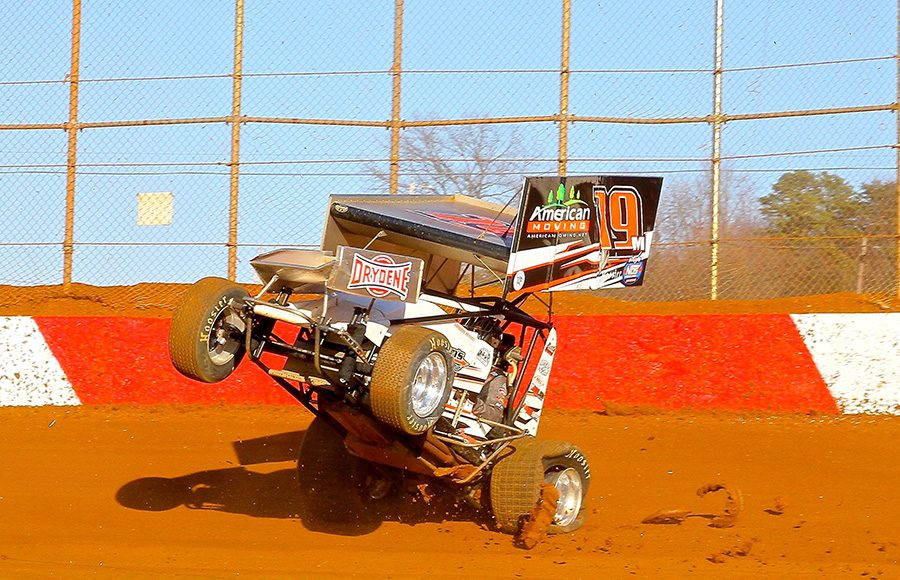 Landon Meyers tries to gather up his sprint car after cutting down a rear tire during Saturday's Ice Breaker event at Lincoln Speedway. (Dan Demarco Photo)