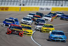 Drivers battle for position during a restart Sunday at Las Vegas Motor Speedway. (HHP/Chris Owens Photo)