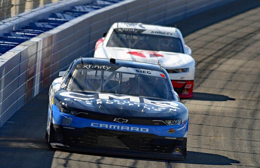 Ryan Sieg (39) leads Michael Annett during Saturday's NASCAR Xfinity Series race at Auto Club Speedway. (Steve Himelstein Photo)