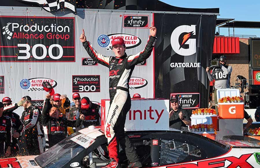 Harrison Burton celebrates in victory lane after winning Saturday's NASCAR Xfinity Series race at Auto Club Speedway. (Steve Himelstein Photo)