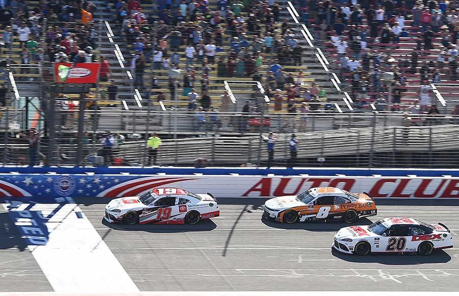 Brandon Jones (19) leads the field to the green flag to start Saturday's NASCAR Xfinity Series race at Auto Club Speedway. (NASCAR Photo)