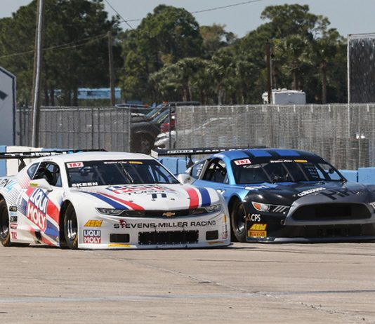 Mike Skeen (left) battles Thomas Merrill for the race lead during a restart in Sunday's Trans-Am Series TA2 event.