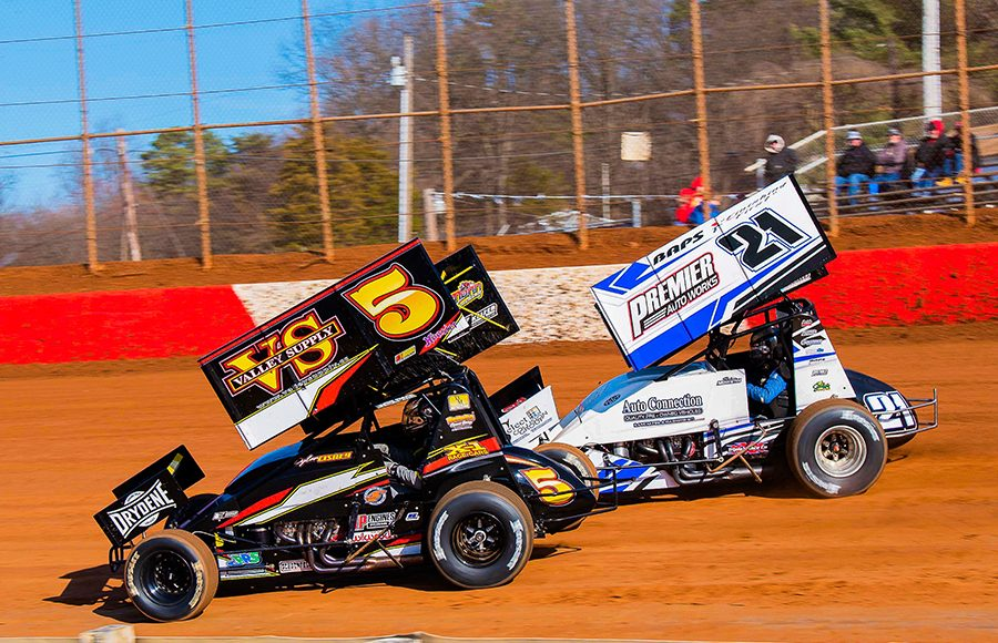 Dylan Cisney (5) races alongside Brian Monteith during Sunday's sprint car event at Lincoln Speedway. (Shawn Cooper Photo)