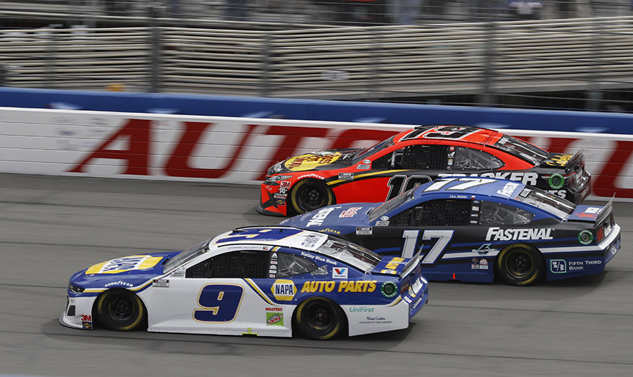 Chase Elliott (9), Chris Buescher (17) and Martin Truex Jr. battle three-wide during Sunday's NASCAR Cup Series event at Auto Club Speedway. (HHP/Andrew Coppley Photo)