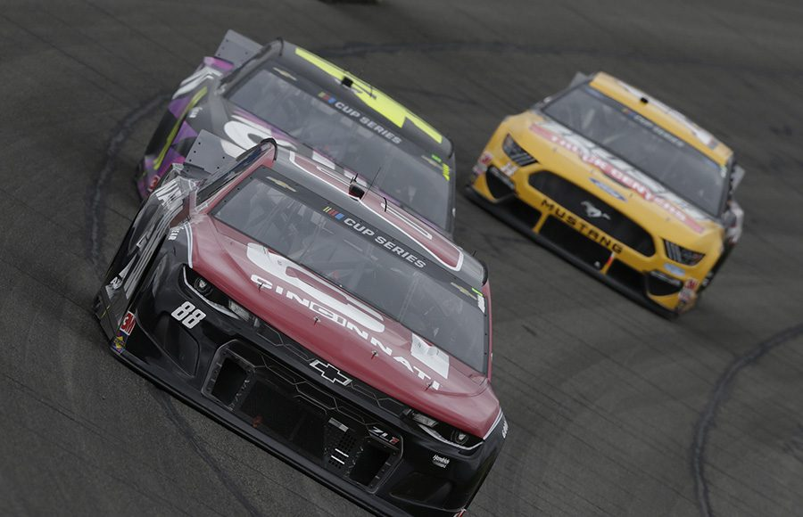 Alex Bowman (88) speeds ahead of Jimmie Johnson (48) and Clint Bowyer (14) during Sunday's NASCAR Cup Series event at Auto Club Speedway. (HHP/Garry Eller Photo)