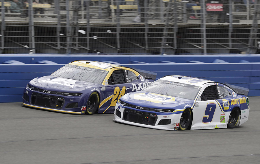 Chase Elliott (9) races alongside William Byron during Sunday's NASCAR Cup Series event at Auto Club Speedway. (HHP/Harold Hinson Photo)