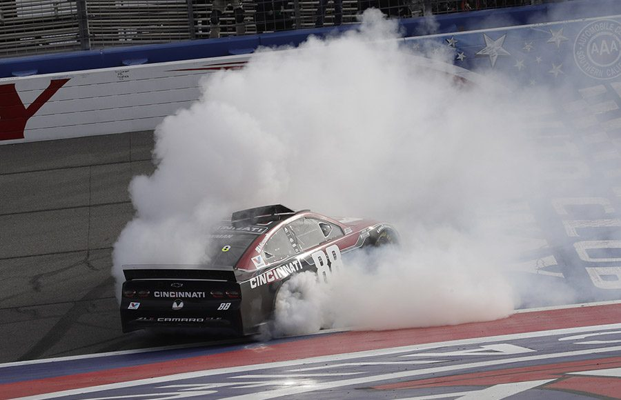 Alex Bowman celebrates after winning Sunday's Auto Club 400 at Auto Club Speedway. (HHP/Harold Hinson Photo)