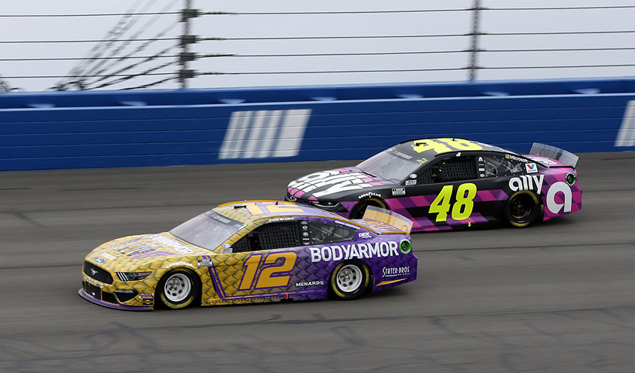 Ryan Blaney (12) races past Jimmie Johnson during Sunday's Auto Club 400 at Auto Club Speedway. (HHP/Tami Pope Photo)