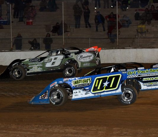 Tyler Erb (c8) passes Jesse Stovall on the last lap to win Friday's COMP Cams Super Dirt Series opener at Boothill Speedway. (Scott Burson Photo)