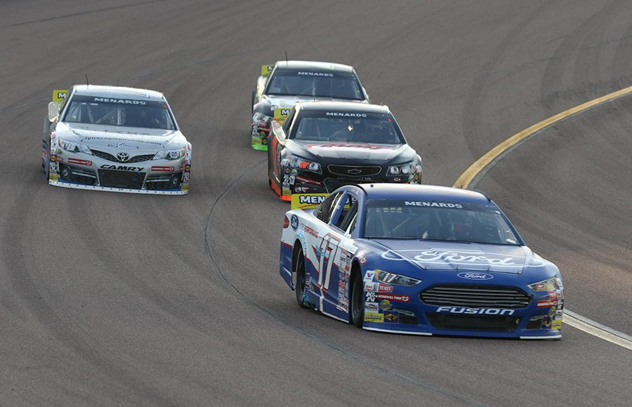 Tanner Gray (17) races ahead of a pack of cars during Friday's ARCA Menards Series race at Phoenix Raceway. (Ivan Veldhuizen Photo)
