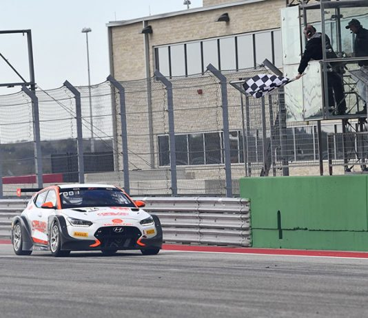 Tyler Maxson takes the checkered flag to win Saturday's TC America opener at Circuit of the Americas.