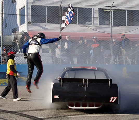 Taylor Gray celebrates after winning the late model stock car portion of Saturday's CARS Solid Rock Carriers Tour opener at Southern National Motorsports Park. (Jason Reasin Photo)