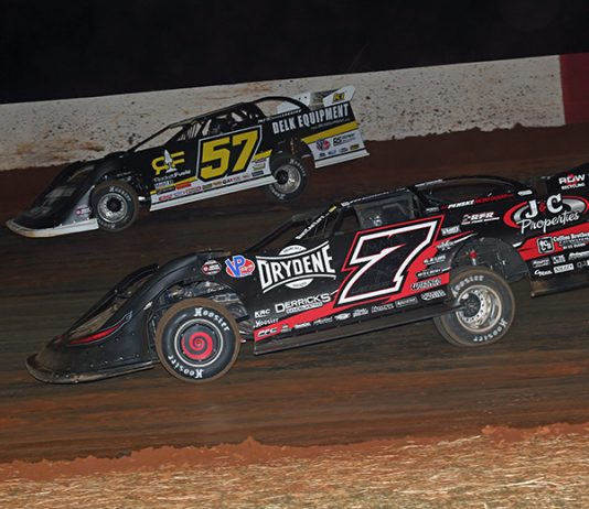 Mike Marlar (57) battles around the outside of Ricky Weiss during Saturday's World of Outlaws Morton Buildings Late Model Series feature at Smoky Mountain Speedway. (Chad Wells Photo)