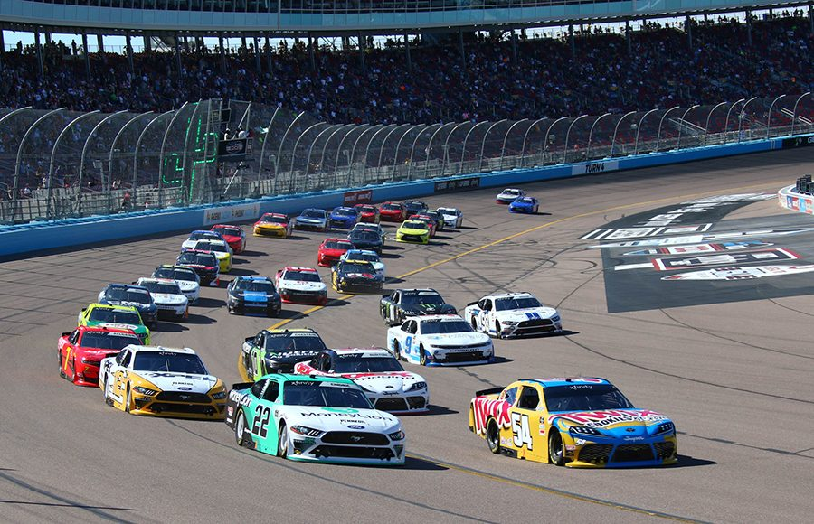 Kyle Busch (54) and Austin Cindric (22) lead the way at the start of Saturday's NASCAR Xfinity Series race at Phoenix Raceway. (Ivan Veldhuizen Photo)