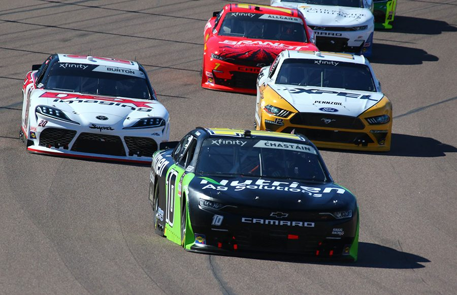 Ross Chastain (10) leads a pack of cars during Saturday's NASCAR Xfinity Series event at Phoenix Raceway. (Ivan Veldhuizen Photo)