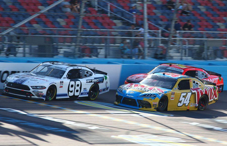 Chase Briscoe (98) battles Kyle Busch (54) and Justin Allgaier during Saturday's NASCAR Xfinity Series event at Phoenix Raceway. (Ivan Veldhuizen Photo)