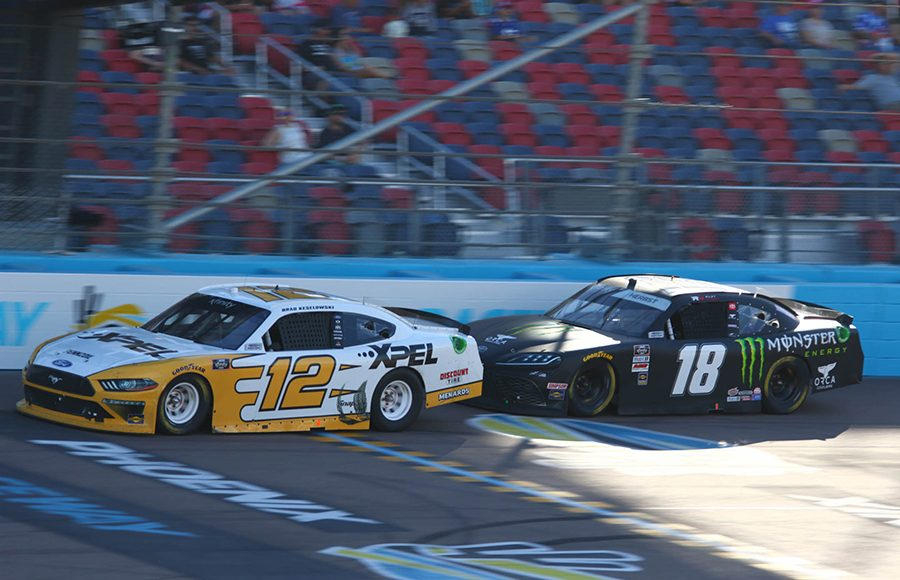 Brad Keselowski (12) races ahead of Riley Herbst during Saturday's NASCAR Xfinity Series event at Phoenix Raceway. (Ivan Veldhuizen Photo)
