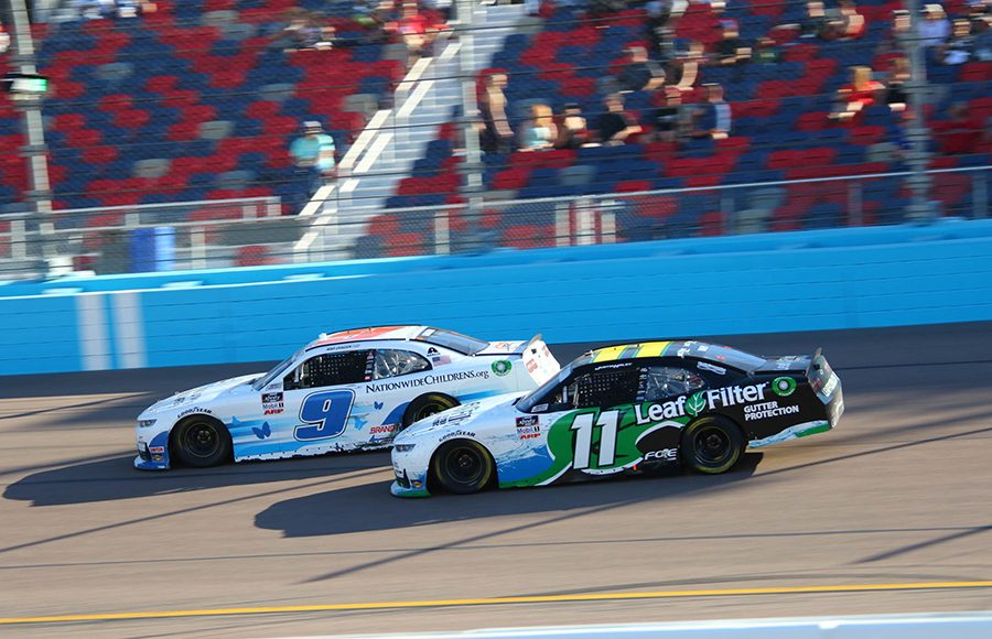 Noah Gragson (9) battles Justin Haley during Saturday's NASCAR Xfinity Series event at Phoenix Raceway. (Ivan Veldhuizen Photo)