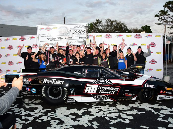 Alex Laughlin celebrates in victory lane after winning the Pro Mod portion of the Doorslammer Nationals. (Roger Richards Photo)