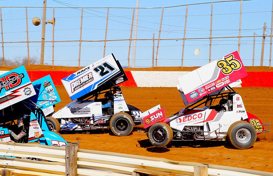 Brian Montieth (21) races ahead of Zach Hampton during Saturday's sprint car feature at Lincoln Speedway. (Dan Demarco Photo)