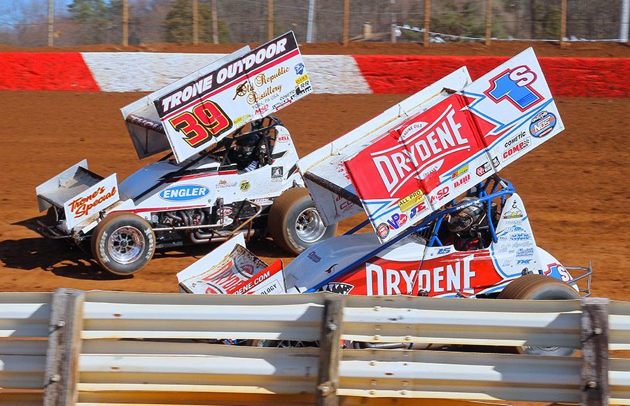 Logan Schuchart (1s) races under Cale Thomas during Saturday's sprint car feature at Lincoln Speedway. (Dan Demarco Photo)