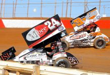 Lucas Wolfe (24) races under Brock Zearfoss during Saturday's sprint car feature at Lincoln Speedway. (Dan Demarco Photo)